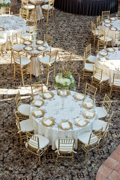 Elegant gold wedding reception set up. I love these chairs, but I would like sma… Elegant gold wedding reception set up. I love these chairs, but I would like smaller tables. Cream Wedding, Wedding Ties, Gold Wedding, Gold Chargers Wedding, Gatsby Wedding, Wedding Budget Breakdown, Budget Wedding, Wedding Planning, Wedding Reception Decorations