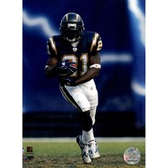 LaDainian Tomlinson Home Action 8x10 Photo - This is an LaDanian Tomlinson photo. Gifts > Collectibles > Nfl Memorabilia. Weight: 1.00
