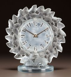 R. LALIQUE CLEAR AND FROSTED GLASS ROITELETS CLOCK Circa 1931. Stenciled R. LALIQUE