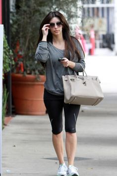 Kim Kardashian wearing Nike capris Hermes Birkin Bag in Gris Tourterelle American Apparel Lightweight Raglan Pullover Nike Everyday Fit+ Trainers Chanel 4189TQ CC Logo Aviator Sunglasses. Kim Kardashian At The Gym February 19 2011.