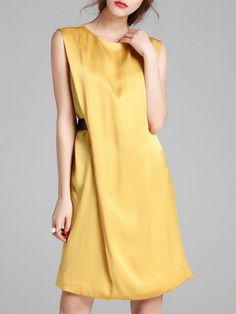 Interesting way to leave a little volume, add interest, conceal the tummy.  Shop Midi Dresses - Yellow H-line Sleeveless Solid Midi Dress online. Discover unique designers fashion at StyleWe.com.