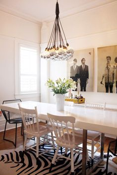 Justine & Angus : Justine & Angus : Apartment Therapy - love the pictures in the dining room and the glossy white table