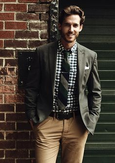 Gingham shirt, striped tie, brown pants.