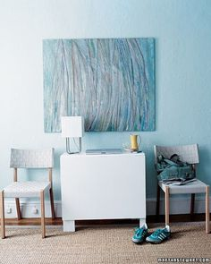 A bright wall hanging provides a burst of color on pale walls.