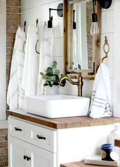 Vintage Inspired Farmhouse Bathroom Makeover Vintage inspired farmhouse bathroom – lots of shiplap, white, wood tones, and mixed metals. You won't believe what it looked like before! Rustic Master Bathroom, Bathroom Vanity Decor, Bathroom Styling, White Bathroom, Bathroom Ideas, Bathroom Remodeling, Bathroom Mirrors, Bathroom Lighting, Ikea Bathroom