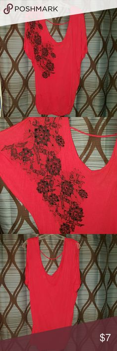 Charlotte Russe Red Sleeveless Tunic Red Tunic top with deep v front and back and black floral detail on right shoulder. Banded bottom Charlotte Russe Tops Tunics