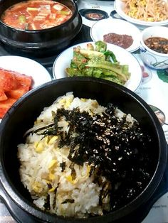 A slow food Korean meal called 'Sprout Rice' together with side dishes.