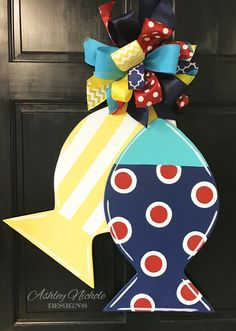 This Fishy-Fishy Door Hanger is a great way to decorate at the lake, pool, beach or home for the summer! Made from plywood with a painted back for a more polished look. Dimension: 22 H x 23 W Burlap Crafts, Wooden Crafts, Wooden Diy, Diy Crafts, Wooden Door Hangers, Wooden Doors, Wooden Signs, Wooden Cutouts, Front Door Decor