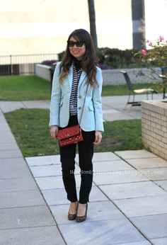 Linda wears stripes under a baby blue jacket with a red Chanel bag as a pop of color (from Nom Nom Bling Bling)