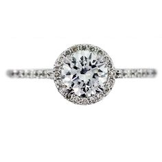 boca_raton_engagement_ring. Love the Halo with the small diamonds around the center stone instead of the big gaudy ones
