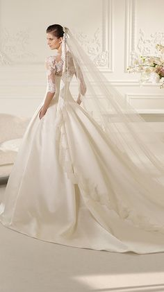 Nelson by White One for Pronovias. So glad lace and sleeves are coming back