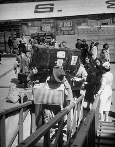 Refugees of the Chinese Civil War boarding a ship. Photograph by Jack Birns. Shanghai, China, May 1949.