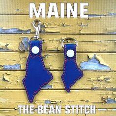 Maine - Includes TWO(2) Sizes!  #thebeanstitch #beanstitchers #TBS #ith #inthehoop #machineembroidery #felties #feltie #embroidery #digitaldownload #keyfobs #bagtag #diy #snaptab #snapbean #handmade #vinyl #felt #craft #etsy #shopsmall #embroiderygift #travel #everyday #design #multipurpose #state #Maine #keychain Kam Snaps, Glitter Vinyl, Tbs, Key Fobs, Machine Embroidery Designs, Free Design, Maine, Geek Stuff, Felt