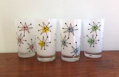 Vintage Fred Press Atomic Starburst Glasses Set of Four by MidCenturyMary on Etsy https://www.etsy.com/listing/216153033/vintage-fred-press-atomic-starburst