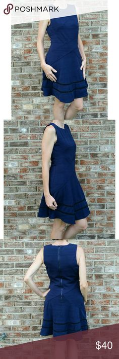🌟Navy Fit and Flare Dress This VERY comfortable, fully lined, sleeveless, navy, textured-knit dress has crisscross seaming and flattering flared skirt with contrast ladder stitching at hem.  Exposed back zipper  100%Cotton Outer, Lining 100% Polyester Dry Clean Only NO TRADES Adelyn Rae Dresses
