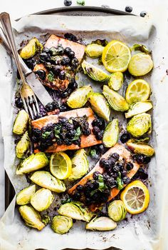 A paleo superfood baked salmon recipe made in one pan! Salmon, Basil, Blueberry Balsamic Vinegar, and a pan full of veggies! Whole 30 friendly recipe here.