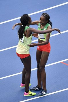 #RIO2016 Ethiopia's Almaz Ayana celebrates winning with bronze medallist Ethiopia's Tirunesh Dibaba after the Women's 10000m during the athletics event at the...