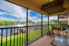 Just Listed!  This tropical waterfront 1st floor condominium fronting the Earman River with ocean access provides expansive views of the water overlooking your dedicated boat slip and lift. Upon entering the home is the open gourmet kitchen to the left with stainless steel appliances, crown molding and an inviting breakfast bar. Tile on diagonal. Across from the kitchen is a large utility room with full size washer, dryer and pantry with plenty of room for lots of storage.