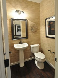 Here's a fabulous use of grasscloth wallpaper in a powder room.  I wouldn't use it in a full bath due to moisture issues, but love it used here.