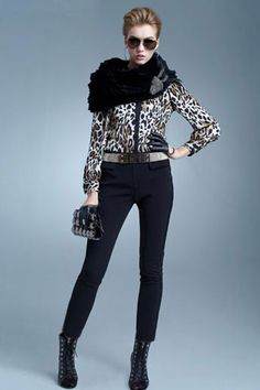 The shirt crafted in polyester, featuring leopard printing, long sleeves, laced neckline and slim fit.