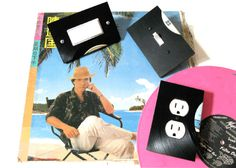 Make an outlet cover. | Community Post: 19 Ways To Reuse Vinyl Records