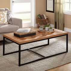 Place this Simple Living Emmerson Coffee Table in any home to create stunning centerpiece. The black metal frame is accented with the natural solid wood top featuring a chevron pattern.