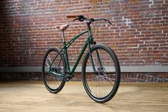 Racing Green No. 3 Budnitz Bicycle with Brooks Honey Leather Saddle and grips. Love the color combo.