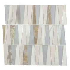 Beautiful handcut glass tile features a trapezoid pattern in mettalic blue, gray and beige colors. Perfect accent for any backsplash, bathroom or feature wall!