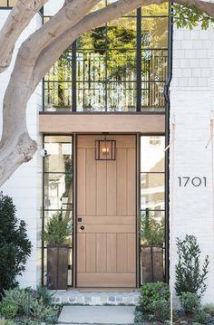 Front door is custom Rift Oak Dutch door Rift Oak Front Door with black windows Rift Oak Door Rift Oak Front Door #RiftOak #Frontdoor #Dutchdoor #door #blackwindows