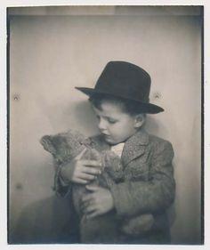 Cute little boy with a teddy bear. #vintage #photobooth