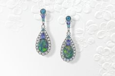 Platinum earrings featuring removable Opal enhancers (15.64 ctw.) accented with blue Zircons (3.27 ctw.), Tanzanites (3.53 ctw.), Paraiba Tourmalines (.40 ctw.) and Diamonds (5.79 ctw.