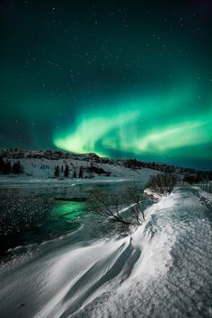 Northern lights over Thingvellir National Park, Iceland. The aurora season will…
