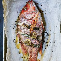 This whole fish stuffed with herbs, lemon and aromatics is easy to prepare and makes a gorgeous, hands-off main dish. This whole fish stuffed with herbs, lemon and aromatics is easy to prepare and makes a gorgeous, hands-off main dish. Fish Dishes, Seafood Dishes, Fish And Seafood, Seafood Recipes, Grilled Fish Recipes, Herb Recipes, Wine Recipes, Cooking Recipes, Sardine Recipes