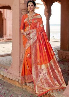 Product Features: Color: Orange Fabric: Art Silk Blouse Color: Orange Saree Length: Meters Blouse Length: Meters Type Of Work: Weaving Disclaimer: Color and Texture may have slight variation due to photography Silk Saree Kanchipuram, Chiffon Saree, Embroidered Clothes, Embroidered Silk, Indian Wedding Outfits, Indian Outfits, Orange Saree, Plain Saree, Orange Fabric
