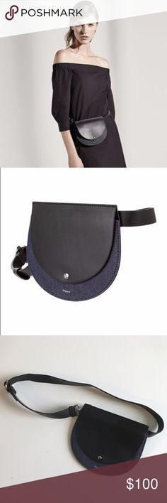 """THEORY POST SADDLE BELT BAG Excellent condition. THEORY POST SADDLE BELT BAG $325 Black Leather Denim Waist Purse Fanny Pack. Genuine Leather Black with Dark Wash Denim Flap with Snap Closure Silver Tone Hardware Belt Measures 39"""" End to End This bag is very small and flat. There are some very minor scuffs in the leather. No trades, no pp. Theory Bags Mini Bags"""
