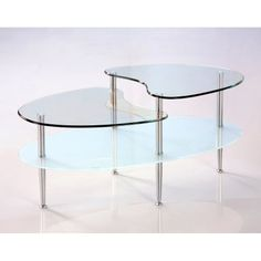 "38"" Oval Clear and Frosted Glass Multilevel Coffee Table by Home Accent Furnishings. $84.99. Beautiful, frosted finish on lower shelving. Sparkling, chrome-finished steel legs. Oval-shape with distinct curving lines. Ships ready-to-assemble with necessary hardware and tools. Beveled, tempered safety glass, top shelf is 8mm thick, lower are 6mm. This stylish, contemporary coffee table features distinctive curved lines and frosted lower shelving. Three levels of glass c..."