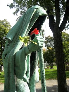 chicago-the most famous statue at Bohemian National Cemetery. This larger-than-life bronze sculpture was designed by Albin Polasek. It represents Death, in the form of an old woman, walking toward the Stejskal-Buchal mausoleum. The figure's face is overshadowed by its hood. Bounded by Foster Ave., Pulaski Rd., Bryn Mawr Ave., and Central Park Ave., the cemetery is recognized on the National Register of Historic Places.