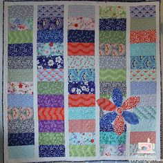 """Jumbo Coins Quilt - 5x10"""" fabric strips with 2"""" sashing."""
