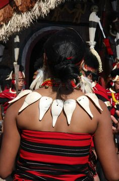 India ~ Nagaland | Details of a woman's necklace from the back. Hornbill Festival | ©Sensaos