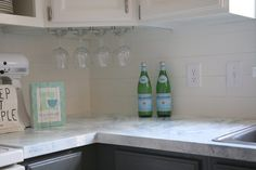 If you thought I was excited about painting my cabinets… or my faux marble painted countertops… you obviously haven't heard me talk about this shiplap inspired backsplash! Click NEXT to see the full article… The Doors, Painting Countertops, Concrete Countertops, Peel And Stick Floor, Wooden Corbels, Empty Glass Bottles, Fancy Kitchens, Faux Shiplap, Marble Painting