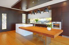 Love this! Chunky cantilevered island makes a big statement in this large kitchen.  Via Pinterest.
