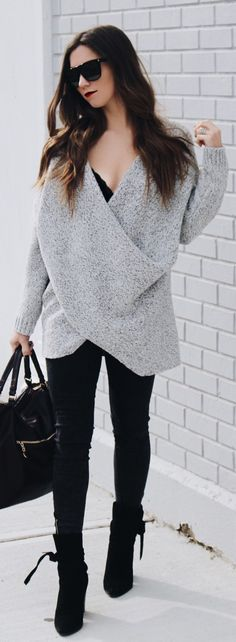 Grey Bandage Knit / Black Leather Tote Bag / Black Suede Booties / Black Skinny Jeans                                                                             Source