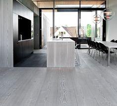 flush flooring segue between living and kitchen area