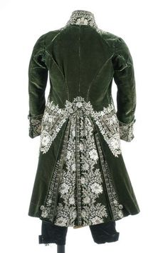 A gentleman's embroidered green velvet court coat and matching ivory satin waistcoat, French, circa 1790, heavily embellished with floss silk flowerheads and foliage; together with a pair of later black satin breeches