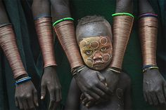 A young boy stands among Suri women wearing copper bracelets in Kibish Ethiopia. The image was taken by Danny Yen Sin Wong of Malaysia who won the title of best single image in the 'faces, people, cultures' category Photographie National Geographic, National Geographic Photography, National Geographic Photo Contest, Population Du Monde, Cool Pictures, Cool Photos, Amazing Photos, Funny Pictures, Travel Specials