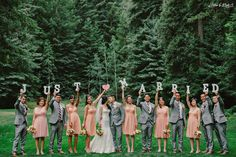 """""""Just Married!"""" sweet bridal party photo - the peach bridesmaids dresses work really well with the guy's grey suits."""
