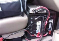 Here is a basic electrical set up. It has a pair of AGM batteries  on the floor below the passenger seat of a van. It is being  charged from the alternator and a 135 watt solar panel. An  inverter sits on top to provide 110 volt power.