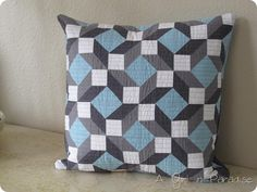 How stunning! This is an awesome re-worked Lemoyne Star Block in ths Star-Crossed Lovers pillow by Ann of A Girl In Paradise.