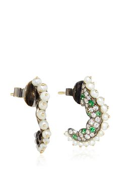 These **Arunashi** earrings feature exquisite vibrant stones highlighted by decadent diamonds which epitomizes the brand's art deco aesthetic