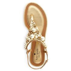 Have an old pair of sandals? You can make them look right out of a kate spade shop by just simply gluing on some little gems and pears!